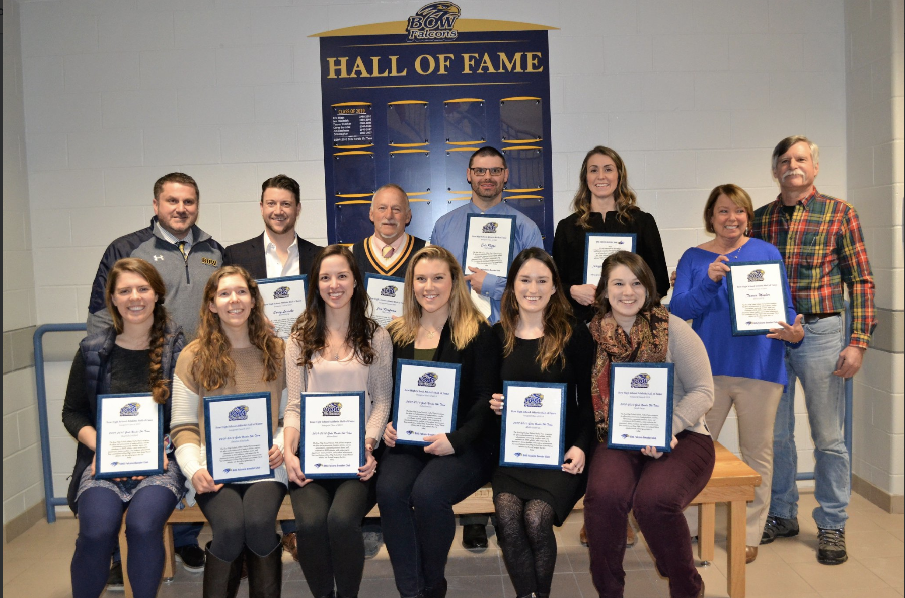 (Back row left to right: Athletic Director Mike Desilets, Corey Laroche, Jim Kaufman, Eric Riggs, Jen Haubrich (Fithian), and the parents of Tanner Mosher)  (Front row left to right: Rachel Gottlieb, Kristen Chulada, Allison Baier, Julia Romano, Abbie Holmes, and Sarah Large)